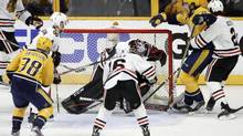 Nashville Predators left wing Filip Forsberg celebrates after scoring a goal against Chicago Blackhawks goalie Corey Crawford during the third period in Game 3 of the teams' playoff series on Monday, April 17, 2017, in Nashville, Tenn. (Mark Humphrey/AP)