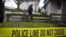 Police tape is used to section off a crime scene in Vancouver. (John Lehmann/The Globe and Mail)