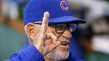Chicago Cubs manager Joe Maddon talks with players in the dugout before a game against the Pittsburgh Pirates on Sept. 27, 2016. (Gene J. Puskar/The Associated Press)