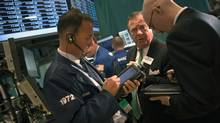 Traders work on the floor of the New York Stock Exchange in New York July 19, 2012. (KEITH BEDFORD/REUTERS)