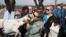 Singer Demi Lovato accepts the gift of a goat on her 21st birthday in Kenya with Free the Children. Joe Jonas fetches water from a river, just as women there do, in the Maasai Mara national reserve. (Scott Ramsay)