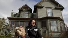 Wildrose party Leader Danielle Smith outside her home with her dog Caine in High River, Alta. (Deborah Baic/The Globe and Mail)