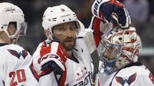 Washington Capitals left wing Alex Ovechkin, center, in the third period of an NHL hockey game Wednesday, March 29, 2017, in Denver. (David Zalubowski/AP)