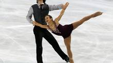 Eric Radford, left, and Meagan Duhamel, right, of Canada, perform in the pairs free skating at the ISU Figure Skating Eric Bompard Trophy, at Bercy arena in Paris, Saturday, Nov. 17, 2012. (Michel Euler/AP)
