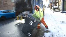 A garbage collection crew picks up residential trash and recycling in Toronto, Ont. Jan. 19, 2012. (Kevin Van Paassen/The Globe and Mail/Kevin Van Paassen/The Globe and Mail)