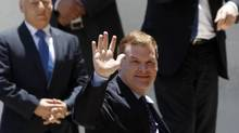 Canada's Foreign Minister John Baird waves upon his arrival for a meeting with Palestinian President Mahmoud Abbas in the West Bank city of Ramallah, June 17, 2013. (MOHAMAD TOROKMAN/REUTERS)