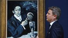 The president of Christie's, Europe, Jussi Pylkkanen in front of a 1903 painting, Portrait of Angel Fernandez de Soto, by Pablo Picasso. The painting is to be auctioned with an estimated price of as much as $59-million (U.S.) The president of Christie's, Europe, Jussi Pylkkanen in front of a 1903 painting, Portrait of Angel Fernandez de Soto, by Pablo Picasso. The painting is to be auctioned with an estimated price of as much as $59-million (U.S.) (Sang Tan/AP/Sang Tan)