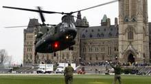 A Canadian Forces CH-147 Chinook helicopter prepares to land on Parliament Hill in Ottawa Thursday May 8, 2014 in preparation for Canada's National Day of Honour taking place Friday. (FRED CHARTRAND/THE CANADIAN PRESS)