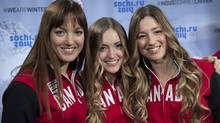 Justine Dufour-Lapointe (right) is one member who will be on the Canadian freestyle ski team. (Paul Chiasson/THE CANADIAN PRESS)