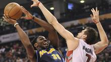 Toronto Raptors forward Andrea Bargnani, right, tries to block Denver Nuggets forward Kenneth Faried, left, during first half NBA basketball action in Toronto on Wednesday, March 28, 2012. (Nathan Denette/Nathan Denette/THE CANADIAN PRESS)