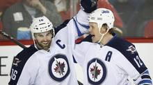 Winnipeg Jets' Olli Jokinen celebrates his goal with teammate Andrew Ladd (Jeff McIntosh/THE CANADIAN PRESS)