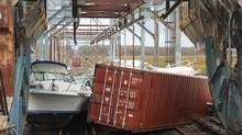 Boats, dumpsters and other debris block the North Jersey Coast Line rail track at Morgan Draw Bridge in New Jersey in the aftermath of super storm Sandy in this October 31, 2012 handout photo. (HANDOUT/REUTERS)