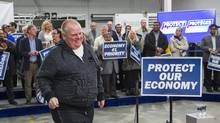 Former Toronto Mayor and current city Councillor Rob Ford arrives to show support for Canada's Prime Minister and Conservative leader Stephen Harper at a campaign rally at William F. White International Inc, a stage lighting equipment supplier in Etobicoke, a suburb of Toronto, October 13, 2015. (MARK BLINCH/REUTERS)