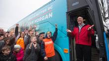 B.C. NDP Leader John Horgan steps off his new campaign bus during an unveiling event in Burnaby on Tuesday. (DARRYL DYCK/THE CANADIAN PRESS)