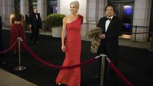 Donald Trump adviser Kellyanne Conway, accompanied by her husband, George, speaks with members of the media as they arrive for a dinner at Union Station in Washington, the day before Trump's inauguration. Trump has chosen George Conway to head the civil division of the Justice Department, the Wall Street Journal has reported. (Matt Rourke/ASSOCIATED PRESS)
