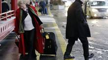 Travelers walk at departure area Terminal 3 at O'Hare International Airport in Chicago on Sunday, Jan. 5, 2014. (Nam Y. Huh/AP)