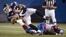 Toronto Argonauts quarterback Ricky Ray (15) is sacked by Montreal Alouettes linebacker Rod Davis (12) during first half CFL pre-season action in Toronto on Tuesday June 19, 2012. (Frank Gunn/THE CANADIAN PRESS)