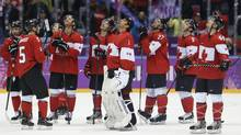 Team Canada watches a replay of Canada defenseman Drew Doughty's game winning sudden death overtime goal against Finland after a men's ice hockey game at the 2014 Winter Olympics, Sunday, Feb. 16, 2014, in Sochi, Russia. (Mark Humphrey/AP)