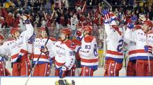 The Washington Capitals bench celebrates against Pittsburgh Penguins in the 2011 NHL's Winter Classic (DAVID DENOMA)