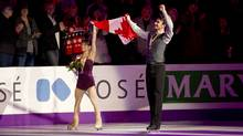 Canada's Meagan Duhamel and Eric Radford celebrate following their pairs free skate at the ISU World Figure Skating Championships 2013 in London, Ont. Friday, March 15, 2013. The pair took the bronze medal in pairs competition. (Kevin Van Paassen/The Globe and Mail)