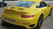 The 2014 Porsche 911 Turbo can go from a standstill to 200 km/h in 11.1 or 10.3 seconds. (Dan Proudfoot for The Globe and Mail)