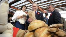 Prince Charles purchases a loaf of bread as he toured a farmer's market at the Brick Works in Toronto, Nov. 6, 2009. (Kevin Van Paassen/Kevin Van Paassen/The Globe and Mail)
