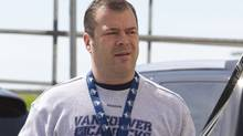 Vancouver Canucks' head coach Alain Vigneault arrives for a team practice at the UBC Thunderbird Arena in Vancouver, B.C., Tuesday, May 17, 2011. The Canucks will play the San Jose Sharks in game 2 of the Western Conference Stanley Cup Final in Vancouver Wednesday. THE CANADIAN PRESS/Jonathan Hayward (Jonathan Hayward/CP)