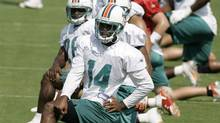 In 2006, then-Dolphins player P.K. Sam flew home to be with his deathly ill father. (Alan Diaz/THE ASSOCIATED PRESS)