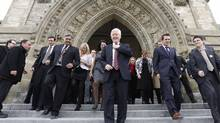 Interim Liberal leader Bob Rae (C) prepares for a group photo on the front steps of Centre Block on Parliament Hill in Ottawa March 27, 2013. (CHRIS WATTIE/REUTERS)