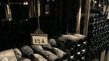 Aging bottles in the cellars of Bouchard Père et Fils, in Beaune, France – not the world's oldest bottles by a long shot. (Ed Alcock/NYT)