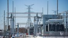 Power lines run out of the the Hydro One Claireville Transfer Station in Vaughan, Ontario Monday March 9, 2015. (Tim Fraser For The Globe and Mail)
