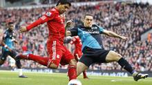 Liverpool's Luis Suarez is challenged by Arsenal's Thomas Vermaelen during their English Premier League match at Anfield in Liverpool, March 3, 2012. (Phil Noble/Reuters/Phil Noble/Reuters)