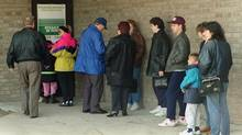 Residents of Deux-Montagnes, a small community near Montreal, line up in front of a Charlottetown Accord polling station before the doors open in this Oct. 26, 1992 file photo. (Ryan Remiorz/The Canadian Press)