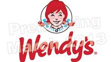 "In the words of a Wendy's press release announcing the changes, has a design that is ""contemporary and iconic, as it further emphasizes the Wendy's cameo while retaining the familiar Wendy's 'wave' design."" The smiling, freckle-faced Wendy stays, but the famous red pigtails have broken out of the black circle that has surrounded her for decades (Mary Wykoff/The Wendy's Company)"