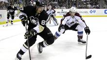 Pittsburgh Penguins' Sidney Crosby (87) works the puck in the corner against Colorado Avalanche's Nathan MacKinnon (29) in the second period of an NHL hockey game in Pittsburgh Monday, Oct. 21, 2013. (Associated Press)
