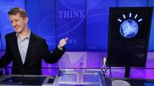 Jeopardy! contestant Ken Jennings with the Watson avatar (Seth Wenig)