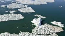 Ice breaking up at Croaker Bay, near Devon's Island, in this 2008 file photo. (Jonathan Hayward/The Canadian Press/Jonathan Hayward/The Canadian Press)