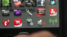 An app for Digital Terror and Hate, middle row, 2nd from right, is seen on a Blackberry Wednesday, May 23, 2012 in Montreal.The app allows law enforcement officials access to a hate and terror report site that tracks over 15,000 problematic web sites, forums and social network pages. (Ryan Remiorz/THE CANADIAN PRESS)