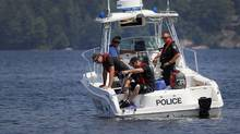 Searchers look for the body of businessman Brad Griffiths in Lake Joseph in Muskoka, July 21, 2011. Moe Doiron/The Globe and Mail (Moe Doiron/Moe Doiron/The Globe and Mail)