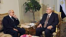 Egypt's interim President Adli Mansour (R) meets with opposition leader and former UN nuclear agency chief Mohamed ElBaradei at El-Thadiya presidential palace in Cairo in this handout picture dated July 6, 2013. Mr. ElBaradei was chosen as Egypt's interim Prime Minister on Saturday as the transitional administration fought to restore calm after at least 35 people were killed in Islamist protests that swept the country. (HANDOUT/REUTERS)