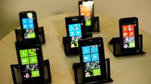 Devices running Windows Phone 7 are on display, a new mobile phone operating system as Microsoft seeks to regain ground lost to the iPhone, Blackberry and devices powered by Google's Android software, during an event in New York, October 11, 2010. (EMMANUEL DUNAND/AFP/Getty Images)