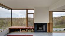Architect Betsy Williamson often incorporates large windows into her work. A weekend retreat that her firm, Williamson Chong Architects, designed in Ontario's Georgian Bay, for example, has a deep, solid-maple seat nestled against a window-filled corner. (Bob Gundu/Williamson Chong Architects)