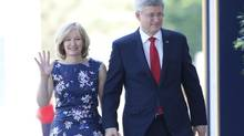 Prime Minister Stephen Harper and his wife Laureen arrive for the swearing in of the federal cabinet at Rideau Hall in Ottawa on Monday, July 15, 2013. (PATRICK DOYLE/The Canadian Press)