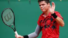 Milos Raonic of Canada reacts after missing a point during his match against Stanislas Wawrinka of Switzerland during their quarter-final match at the Monte Carlo Masters in Monaco April 18, 2014. (ERIC GAILLARD/REUTERS)
