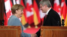 German Chancellor Angela Merkel shakes hands with Canadian Prime Minister Stephen Harper after a joint press conference on Parliament Hill in Ottawa, Thursday, August 16, 2012. German senior government official Uwe Beckmeyer said Canadian officials seem open to the possibility of further changes to the Canada-EU free trade pact, but Canadian government sources strongly rejected that view, insisting that negotiations are over. One government source indicated that Chancellor Merkel had never raised objections over investor-state provisions with Prime Minister Harper. (PATRICK DOYLE/THE CANADIAN PRESS)