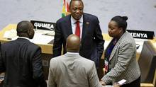 Kenyan President Uhuru Kenyatta, middle, is slated to go on trial on Nov. 12, but his government plans to withdraw from the ICC. (Tiksa Negeri/REUTERS)