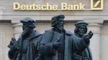 File photo of a statue in front of the former head quarters of Germany's largest business bank, Deutsche Bank in Frankfurt, January 28, 2013. (KAI PFAFFENBACH/REUTERS)