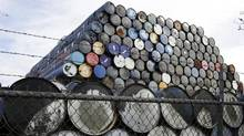 Used oil barrels are stacked at a storage facility in Seattle, Washington February 12, 2015. (JASON REDMOND/REUTERS)