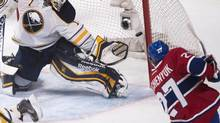 Alex Galchenyuk shoots on Buffalo Sabres goalie Jhonas Enroth (1) during second period NHL action against the Montreal Canadiens in Montreal, Saturday, December 7, 2013. (Peter Mccabe/THE CANADIAN PRESS)