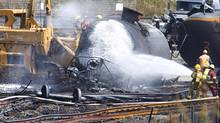 The federal government had announced an initial $60-million in emergency help for Lac Mégantic, Que. (PETER POWER/THE GLOBE AND MAIL)